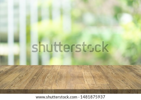 Empty wood table top on blurred background at garden in shopping mall, copy space for montage you product #1481875937