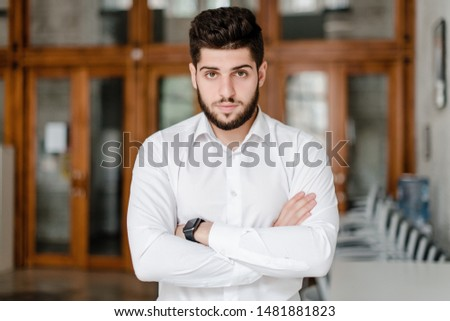 handsome bearded male office worker in white shirt #1481881823