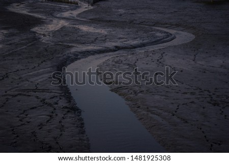The waterway flows, the soil that has been eroded becomes a path of water flowing into the sea. #1481925308