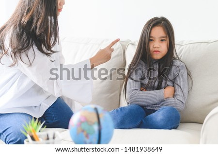 Angry asian mother sitting with little daughter , mom scolds for discipline bad behaviour capricious kid, family generations problems, misunderstanding concept #1481938649