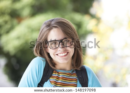 beautiful nerd with glasses and looking at camera #148197098