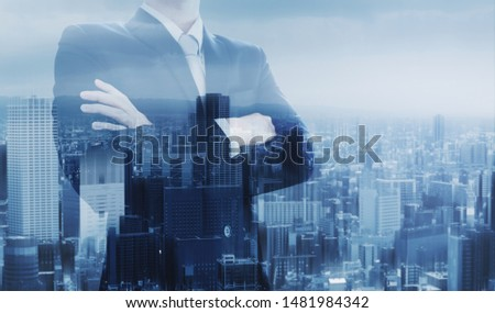 Businessman with arm crossed, double exposure futuristic city #1481984342