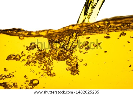 Pouring oil car motor gasoline lubricant engine or olive vegetable cooking and bubble isolated on white background  Royalty-Free Stock Photo #1482025235