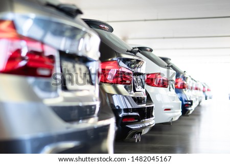 new cars in a row at the dealership #1482045167
