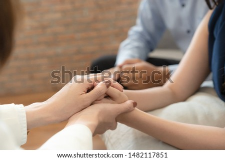 Close-up Doctor hearten, Asian Husband and wife  join hand to encourage while sitting on the sofa,  Health and illness concepts Royalty-Free Stock Photo #1482117851