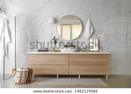 Modern bathroom interior with stylish mirror, vessel sink and glass shower stall #1482129086