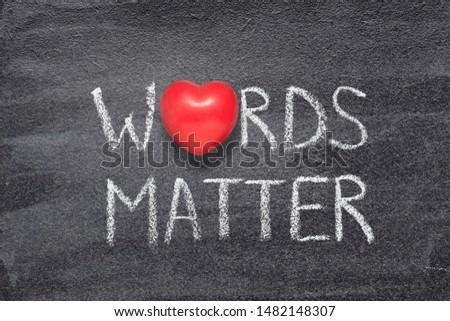 words matter phrase written on chalkboard with red heart symbol