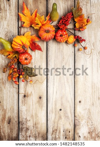 Festive autumn decor from pumpkins, berries and leaves on a rustic wooden background. Concept of Thanksgiving day or Halloween. Flat lay autumn composition with copy space. #1482148535