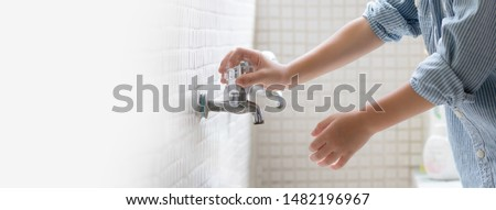 Banner picture of a little boy's hands at the wash basin in the school, He's about to turn on the tap, no water. Washing hands, Kids health, Hygiene, Clean, Water crisis, Saving water, World water day #1482196967