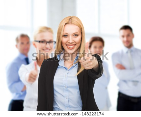 business and success - happy businesswoman showing thumbs up in office #148223174