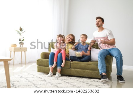 Happy family watching TV at home #1482253682