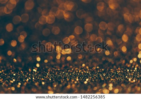 Blur neon gold light circle background. Sparkling firework bokeh dots in retro film filter style. Luxury and classy new year and christmas party textured backdrop. Blurry golden dust particles