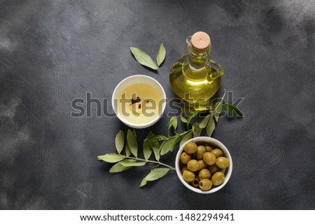 Extra virgin Olive oil , olive branch and olives on a dark background #1482294941