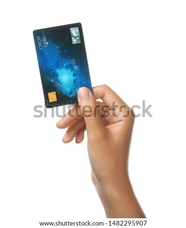 Female hand with credit card on white background Royalty-Free Stock Photo #1482295907