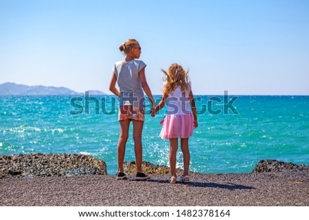 Childs on the background of the sea. #1482378164