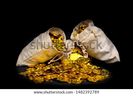 Stacking gold coin in treasure sack at black background #1482392789