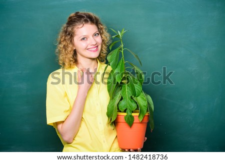 Woman chalkboard background carry plant in pot. Take good care plants. Botany education. Botany is about plants flowers and herbs. Florist concept. Botany and biology lesson. Botanical expert. #1482418736