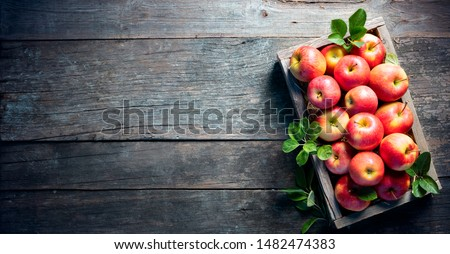 Ripe Apples In Wooden Basket On The Rustic Table  #1482474383