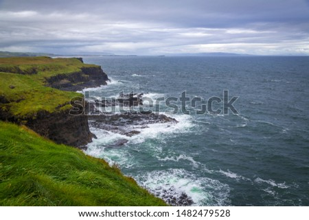 walking at Giant's Causeway at the Antrim Coast, Northern Ireland #1482479528