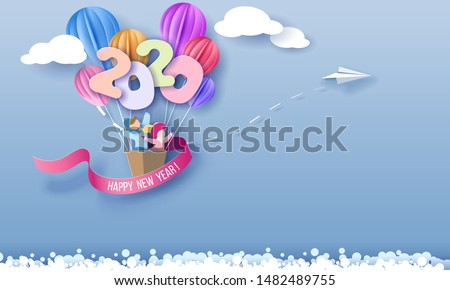 2020 New Year design card with kids in basket of air balloons flying on blue sky background with clouds. Vector paper art illustration. Paper cut and craft style. #1482489755