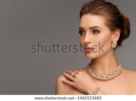 Beautiful girl with set jewelry .   Woman in a necklace with a ring, earrings and a bracelet. Beauty and accessories. #1482513683