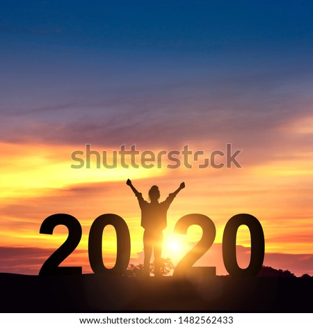 Silhouette freedom young businesswoman Enjoying on the hill and 2020 years while celebrating new year, copy space. #1482562433