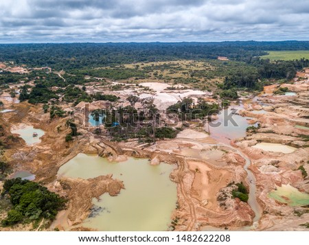 Aerial view of deforested area of the Amazon rainforest caused by illegal mining activities in Brazil. Deforestation and illegal gold mining destroy the forest and contaminate the rivers with mercury. #1482622208