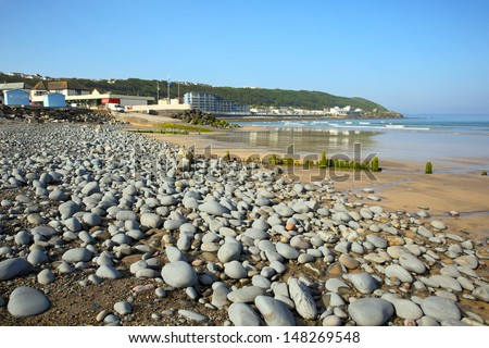 Westward Ho beach and coastline Devon England.  Seaside village near Bideford, facing into Bideford Bay. Royalty-Free Stock Photo #148269548