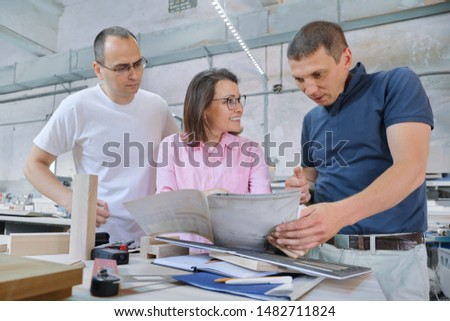Group of working people discussing work process, wood products in carpentry workshop. #1482711824