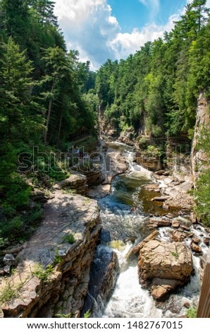 rock ledges and river at AuSable Chasm #1482767015