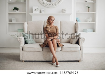Gorgeous pretty lady sitting and holding hands on knees. #1482769196
