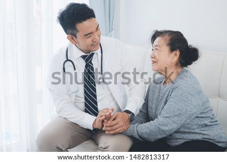 Smart doctor visit elderly woman at home for check up,Elderly health care concept. #1482813317