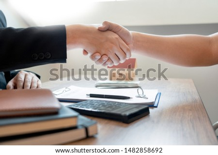 Customer and broker shake hands agreeing to buy new house at meeting after making sale purchase deal or finish buying or rental real estate with agent, Success deals concept. #1482858692