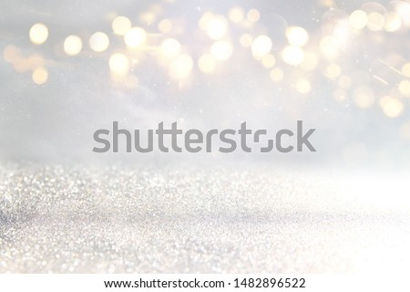 background of abstract glitter lights. silver and gold. de-focused #1482896522