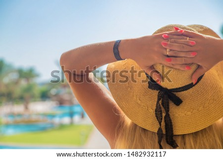 girl looks at the pool and sea. Selective focus. nature. #1482932117