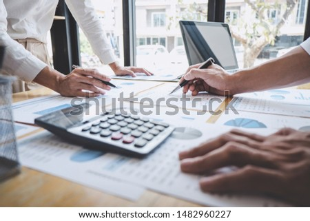 Business casual team manager having a discussion with new project success financial statistics, Partner meeting professional investor working start up project for both company with document. #1482960227