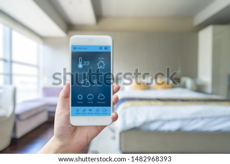 mobile phone with smart home app in modern living room #1482968393