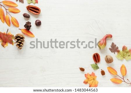 Top view autumn arrangement with wooden background #1483044563