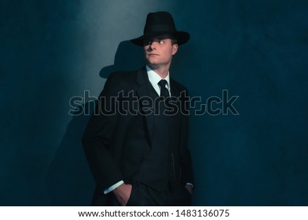 Retro man in hat wears suit and tie. #1483136075