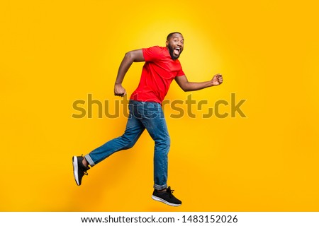 Full length body size photo of casual running man who aspires to achieve what he has planned while isolated with yellow background #1483152026