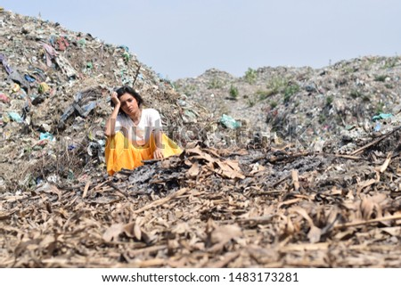 Poverty in India, images of a poor adolescent girl in India among garbage. A scene depicting a life of rag-picker   #1483173281