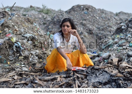 Poverty in India, images of a poor adolescent girl in India among garbage. A scene depicting a life of rag-picker   #1483173323