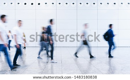 blurred business people crowd at a trade fair Royalty-Free Stock Photo #1483180838