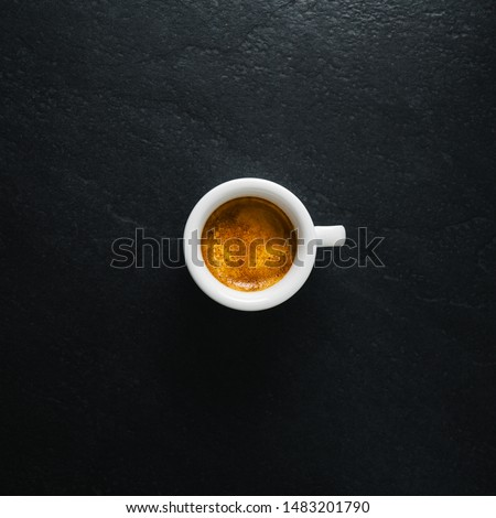 Cup of fresh made coffee served in cup on dark background. Coffee background.  Square.  #1483201790