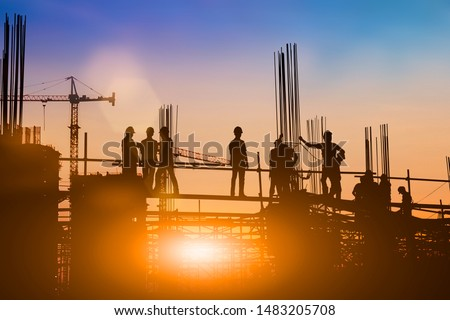 Silhouette of engineer and construction team working at site over blurred background for industry background with Light fair. #1483205708