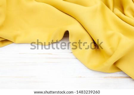Soft yellow fabric, fashion background. #1483239260