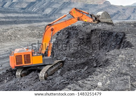 Coal mining with a hydraulic excavator. Coal mining from a vertical face, an open-pit mining method. #1483251479