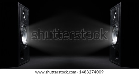 Two sound speakers with free space between them on black  background. Royalty-Free Stock Photo #1483274009
