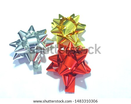 Yellow bow,red bow and silver bow for gift on white background #1483310306