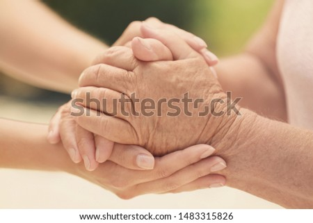 People, care and support. Giving helping hand concept #1483315826